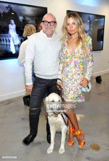 Celebrity floral and fragrance designer Eric Buterbaugh and Erica Pelosini attend the private opening of Sascha von Bismarck debut photography...