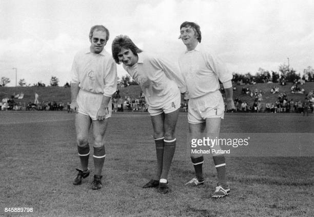 Celebrity football fans Elton John Rod Stewart and Michael Parkinson take part in a charity football match UK 1974