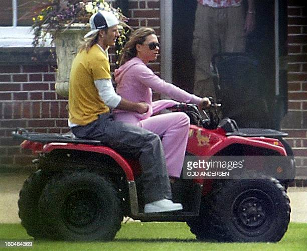Celebrity footballer David Beckham and his wife Victoria ride on a quadbike at their Hertfordshire home 12 April 2004 The Beckhams were back in...
