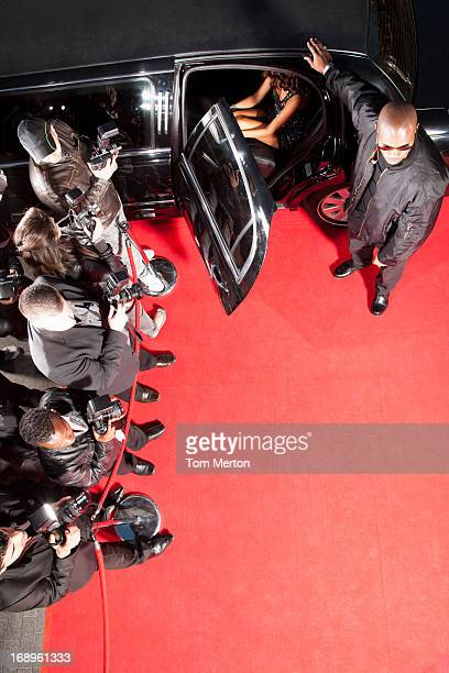 Celebrity getting out of limo on red carpet