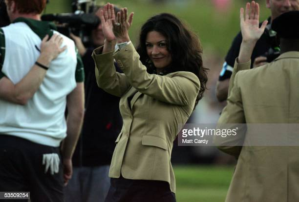 Celebrity golfer Catherine Zeta-Jones applauds her team on the final day of The All-Star Cup Celebrity Golf tournament at the Celtic Manor Resort on...