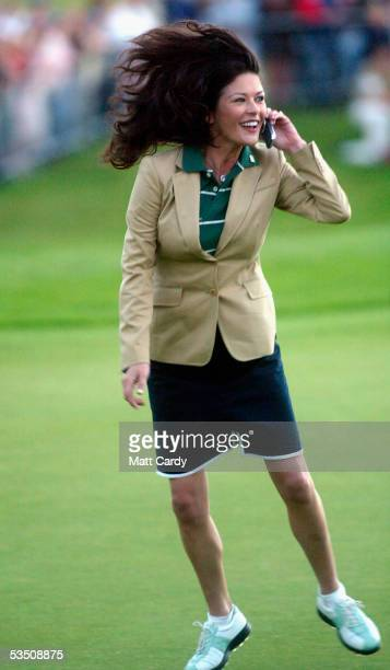Celebrity golfer Catherine Zeta-Jones celebrates whilst talking on a mobile phone on the final day of The All-Star Cup Celebrity Golf tournament at...