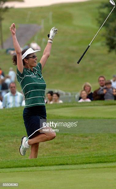 Celebrity golfer Catherine Zeta-Jones cheers and throws her golfclub in the air on the final day of The All-Star Cup Celebrity Golf tournament at the...