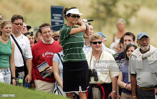 Celebrity golfer Catherine Zeta-Jones shoots from the crowd after fluffing her first shot on the final day of The All-Star Cup Celebrity Golf...
