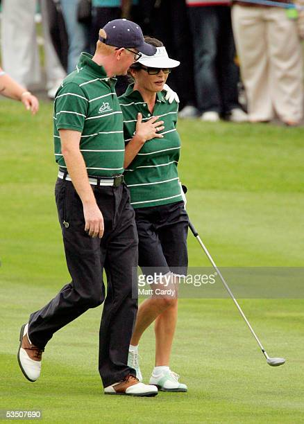 Celebrity golfer Chris Evans comforts Catherine ZetaJones after fluffing her first shot on the final day of The AllStar Cup Celebrity Golf tournament...
