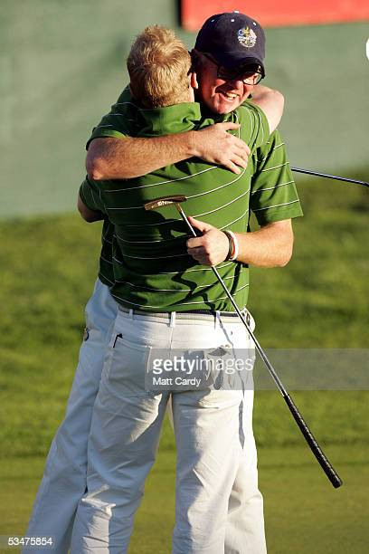 Celebrity golfer Chris Evans hugs his partner Ronan Keating at the end of the first day at The AllStar Cup Celebrity Golf tournament at the Celtic...