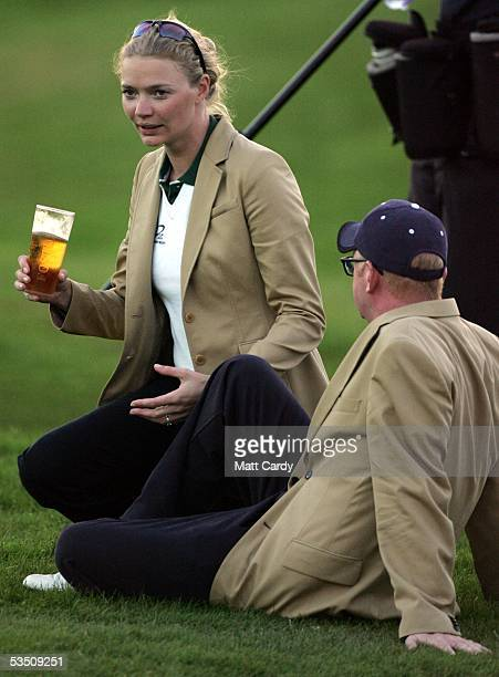 Celebrity golfer Jodie Kidd drinks a pint of lager with Chris Evans on the final day of The AllStar Cup Celebrity Golf tournament at the Celtic Manor...