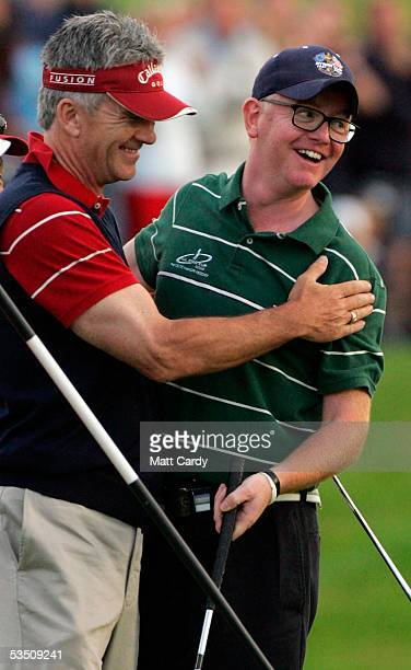 Celebrity golfer Patrick Duffy hugs Chris Evans at the end of their match on the final day of The AllStar Cup Celebrity Golf tournament at the Celtic...