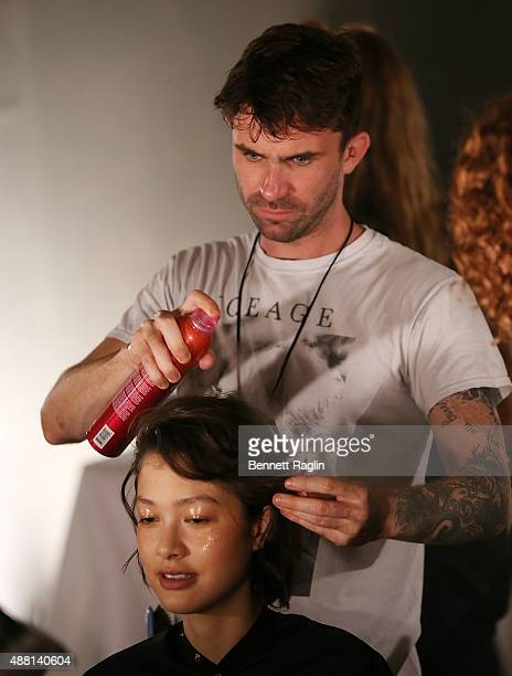 Celebrity hair stylist Anthony Turner prepares a models hair backstage at the Opening Ceremony fashion show during Spring 2016 New York Fashion Week...