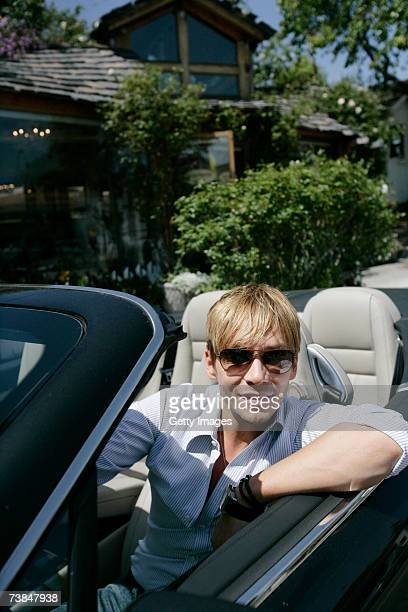 Celebrity hair stylist Ken Paves sits in his convertible Bentley in front of his Beverly Hills California salon on April 9 during a media day event...
