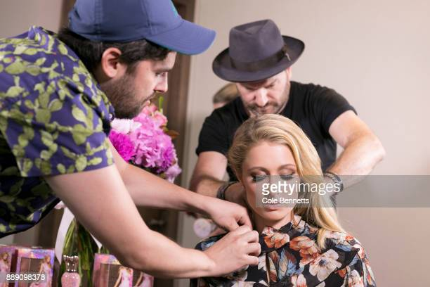 Celebrity hair stylist Michael Brennan and a technician ready Paris Hilton for a TV interview during a promotion visit to Australia to launch her...