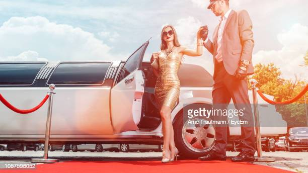 celebrity holding man hand while walking on red carpet - limousine stock pictures, royalty-free photos & images
