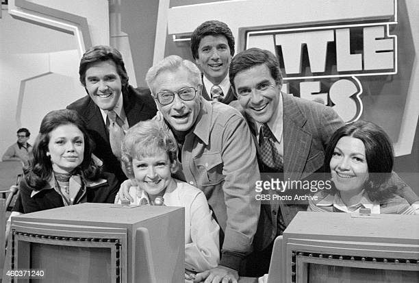 Celebrity husbands and wives on the gameshow TATTLETALES From left Jo Ann Pflug and Chuck Woolery Betty White and Allen Ludden host Burt Convy Pat...