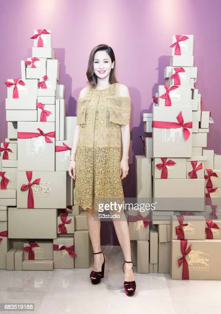Celebrity Model Kathy Chow poses for a photograph on the red carpet at the Burberry Pacific Place event on 03 November 2016 in Hong Kong, China.