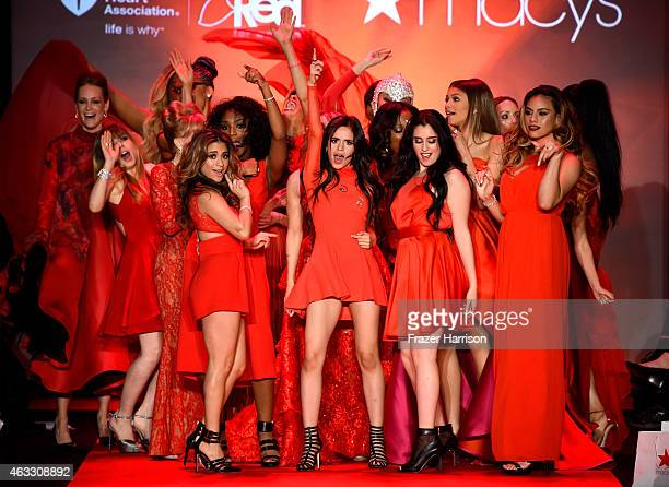 Celebrity models pose on the runway at the Go Red For Women Red Dress Collection 2015 presented by Macy's fashion show during MercedesBenz Fashion...
