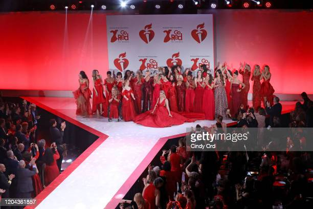 Celebrity models pose onstage during the finale of the American Heart Association's Go Red for Women Red Dress Collection 2020 at Hammerstein...