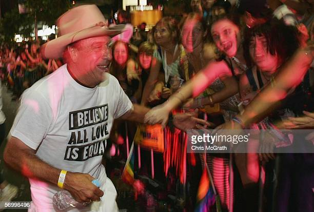 TV celebrity Molly Meldrum mixes with spectators on Oxford street during the 2006 Sydney New Gay and Lesbian Mardi Gras parade March 4 2006 in Sydney...
