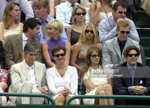 A celebrity packed crowd including Damon Hill and wife Georgie Liz Hurley and Guy Louthmen Anna Kournikova and Sergei Federov and Nick Faldo with...