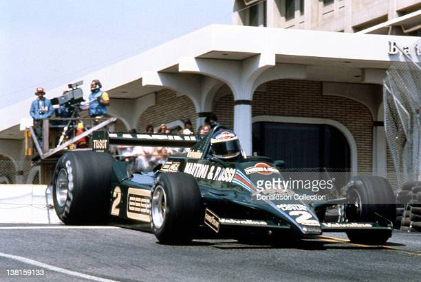 A celebrity participant races an indy car on the streets during the Long Beach Grand Prix in 1979 in Long Beach California