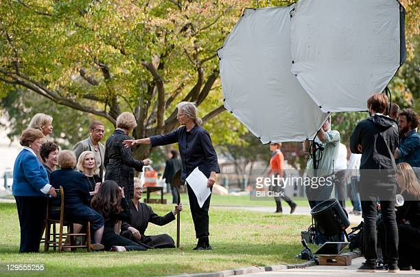 Celebrity photographer Annie Leibovitz center positions her portrait subjects during a photo shoot on the US Capitol grounds on Tuesday Oct 18 2011...