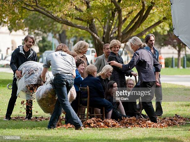 Celebrity photographer Annie Leibovitz center positions her portrait subjects as assistants spread fall leaves during a photo shoot on the US Capitol...