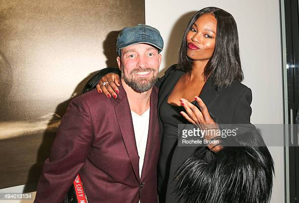Celebrity photographer Brian Bowen Smith and and model/actress Eugenia Washington attend 'Metallic Life' by Brian Bowen Smith brought to you by...