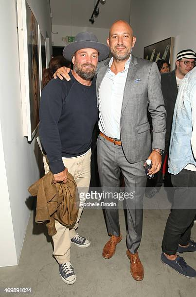 Celebrity photographer Brian Bowen Smith and gallery owner/director Steph Sebbag attend the Mike Sagato The Folly of Youth exhibition at De Re...