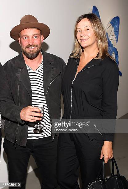 Celebrity photographer Brian Bowen Smith and wife Shea Bowen Smith attend the opening night of Stephanie Hirsch Transformation at De Re Gallery on...