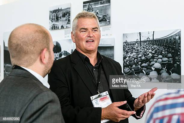 Celebrity photographer Dave Hogan discusses his images at the new Getty Images exhibition at Wembley Stadium on September 3, 2014 in London, England....