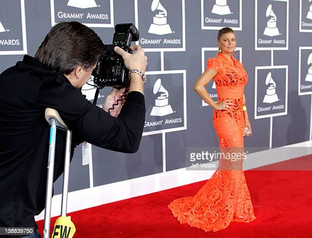 Celebrity photographer Kevin Mazur and singer Fergie of the Black Eyed Peas arrive at The 54th Annual GRAMMY Awards at Staples Center on February 12...
