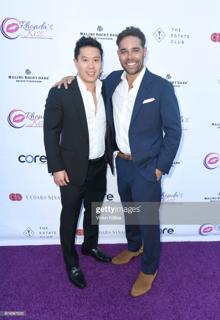 Celebrity plastic surgeon Roger Tsai and executive director of Rhonda's Kiss Kyle Stefanski attend Rhonda's Kiss 'Kiss The Stars' Cancer Fundraising Dinner at The Estate Club's Sky Castle Estate on June 13, 2018 in Los Angeles, California.