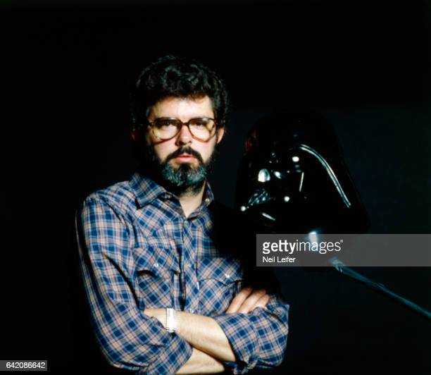 Portrait of Star Wars writer and director George Lucas during photo shoot with movie props at Industrial Light & Magic studios. San Rafael, CA...