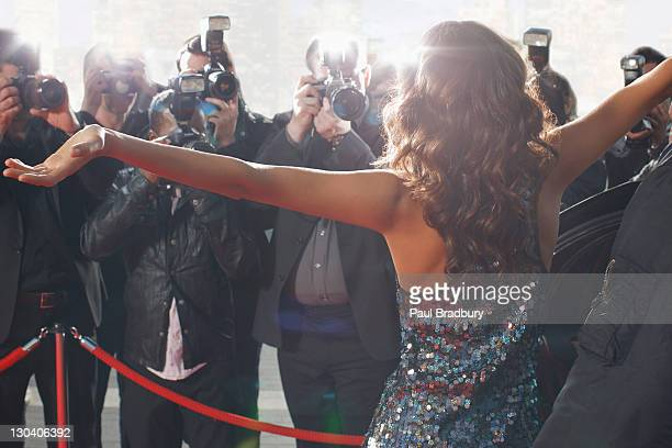 celebrity posing for paparazzi on red carpet - red carpet event stock pictures, royalty-free photos & images