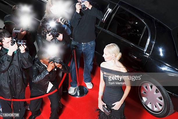 celebrity posing for paparazzi on red carpet - celebrity see through clothes stock pictures, royalty-free photos & images