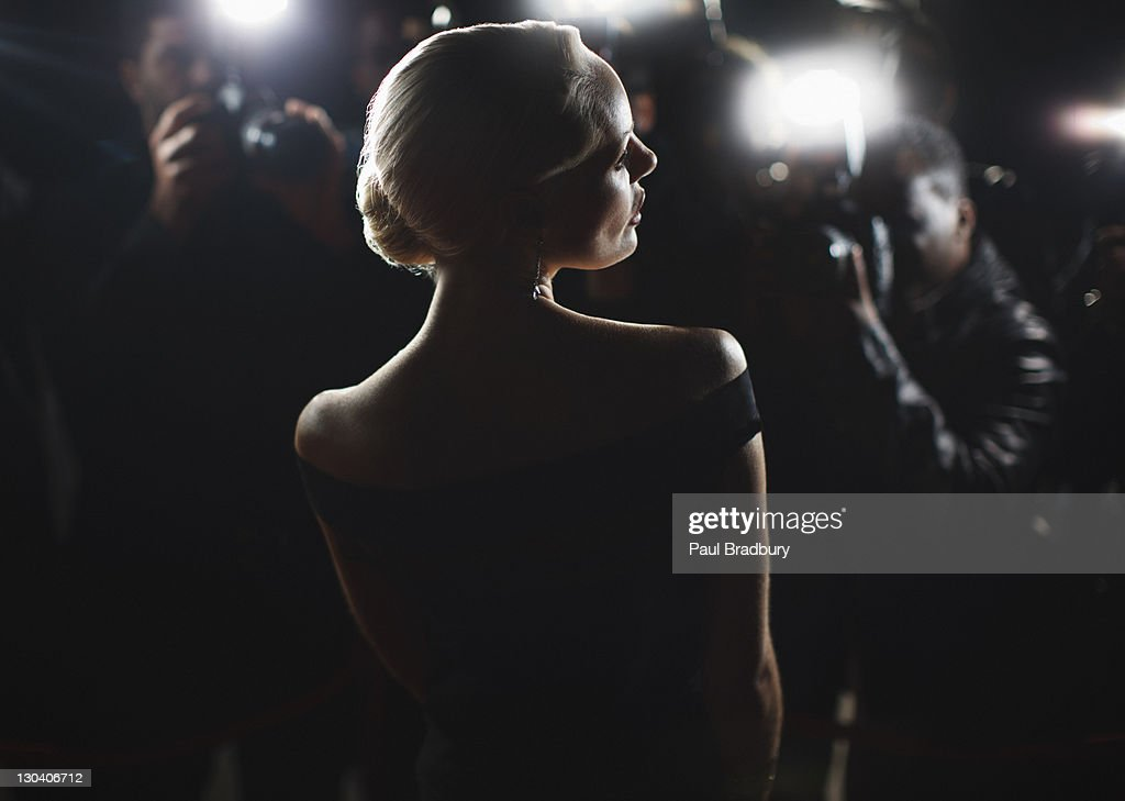 Celebrity posing for paparazzi : Stock Photo