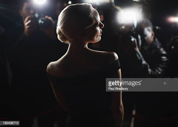 celebrity posing for paparazzi - evening gown stock photos and pictures