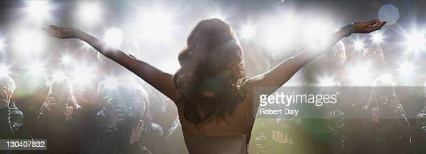 celebrity posing for paparazzi - red carpet event stock pictures, royalty-free photos & images