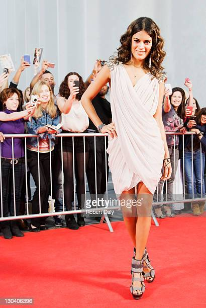 Celebrity posing on red carpet