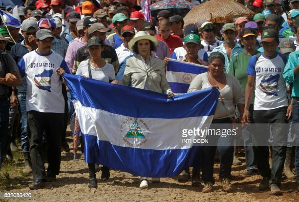 TOPSHOT Celebrity rights activist former actress and exwife of Rolling Stones singer Mick Jagger Bianca Jagger leads a march against the construction...