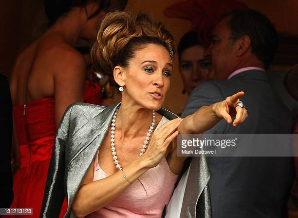Celebrity Sarah Jessica Parker points something out in the crowd from the comfort of a corporate box during Crown Oaks Day at Flemington Racecourse...