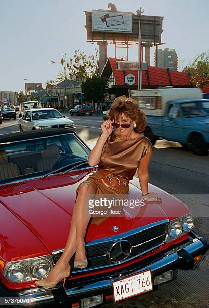 Celebrity sex scandel survivor Jessica Hahn poses for a portrait on the hood of her new Mercedes Benz parked on Sunset Blvd in West Hollywood...