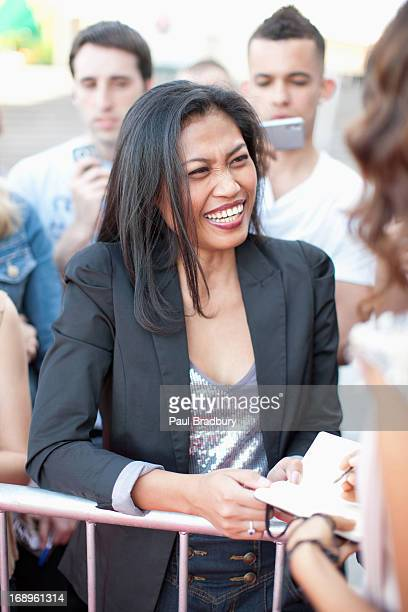 celebrity signing autographs for fan - groupie stock pictures, royalty-free photos & images