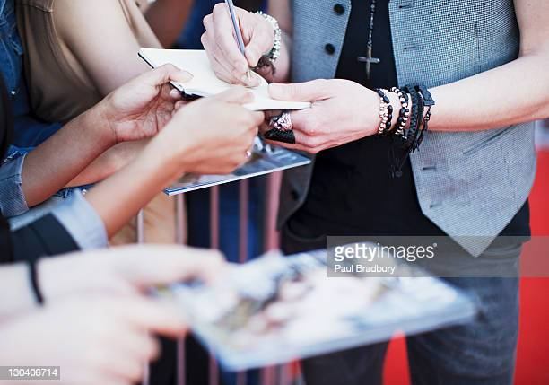 celebrity signing autographs on red carpet - celebritet bildbanksfoton och bilder