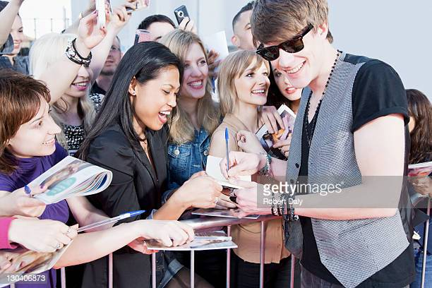 celebrity signing autographs - fame stock pictures, royalty-free photos & images