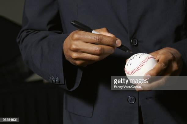 Celebrity signing baseball