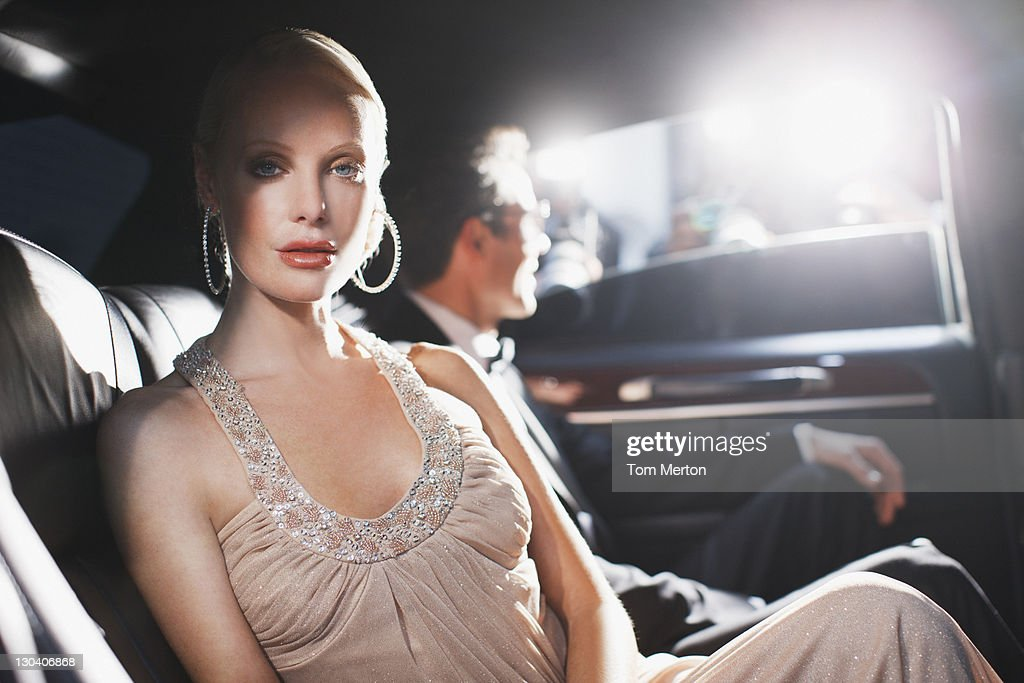 Celebrity sitting in backseat of car : Stock Photo
