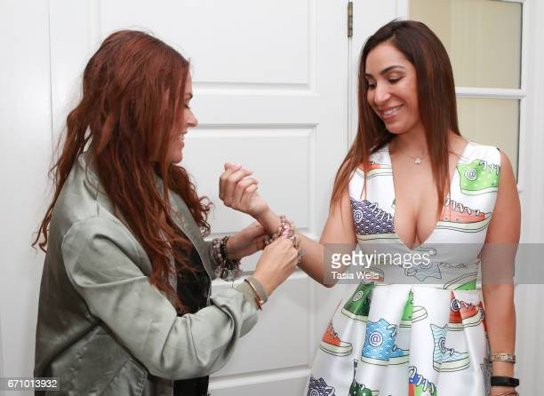 Celebrity stylist Ali Levine wearing LOVE thirteen by Heather Wells bracelets and actress Liana Mendoza wearing LOVE thirteen by Heather Wells...