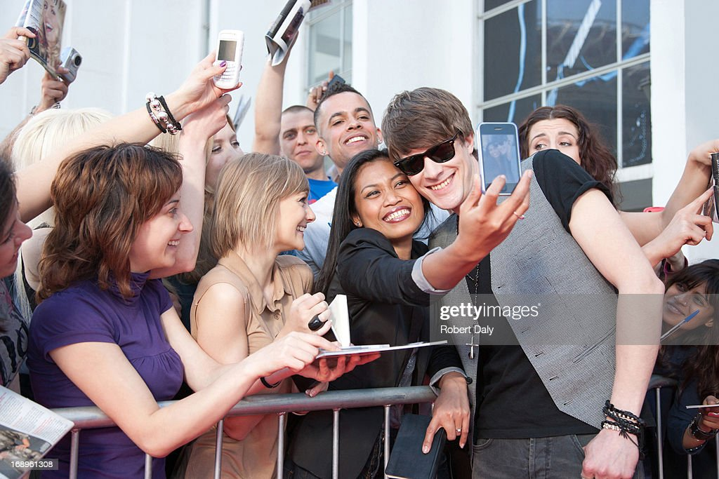Celebrity taking pictures with fans : Stock Photo