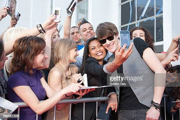 celebrity taking pictures with fans - celebrities stock pictures, royalty-free photos & images