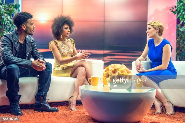celebrity talk show - gold dress stock pictures, royalty-free photos & images